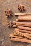 Cinnamon sticks and  star anise on wooden background Royalty Free Stock Image