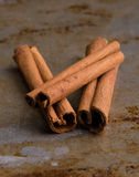 Cinnamon sticks on steel plate Royalty Free Stock Photos