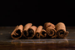 Cinnamon sticks on steel plate Royalty Free Stock Photo