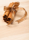 Cinnamon Sticks. Tied with a bow. Copy space below stock photography