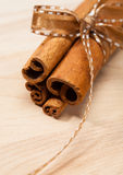 Cinnamon Sticks. Tied with a cute brown bow. Shallow DOF royalty free stock photos
