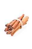 Cinnamon sticks tied over white Royalty Free Stock Image