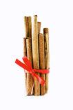 Cinnamon sticks tied with a red bow. On white background royalty free stock photos