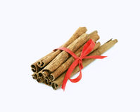 Cinnamon sticks tied with a red bow. On white background stock images