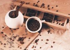 Cinnamon sticks in vase and coffee Stock Photos