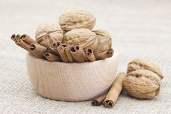 Cinnamon sticks and walnuts Royalty Free Stock Photos