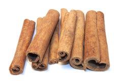 Cinnamon sticks on white background. Aromatic cinnamon sticks on white background Stock Photos
