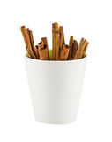 Cinnamon sticks in white mug Royalty Free Stock Images