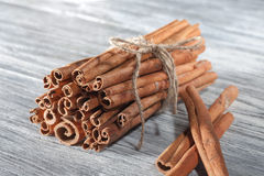 Cinnamon sticks  on white wooden table Royalty Free Stock Images