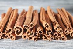 Cinnamon sticks  on white wooden table Stock Photo