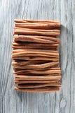 Cinnamon sticks  on white wooden table Royalty Free Stock Photos
