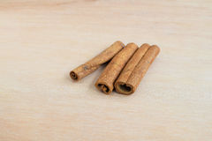 Cinnamon sticks on wood background Royalty Free Stock Images