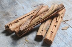 Cinnamon sticks on wood table background Royalty Free Stock Photography