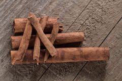 Cinnamon sticks on wooden background Royalty Free Stock Images