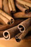 Cinnamon Sticks in Wooden Bowl Close Up Stock Images