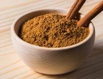 Cinnamon sticks in wooden bowl Royalty Free Stock Photos