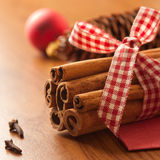 Cinnamon sticks on wooden table Stock Images