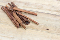 Cinnamon sticks on  wooden Royalty Free Stock Images