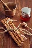 Cinnamon sticks. On a wooden table with bronze grinder Stock Photography