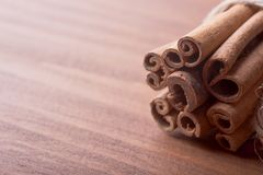 Cinnamon sticks on wooden background royalty free stock image