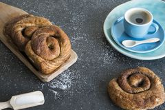 Tea time with Dutch cinnamon, sugar bread roll, called Bolus. stock image