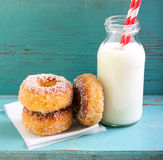 Cinnamon sugar donuts and bottle milk Royalty Free Stock Photos