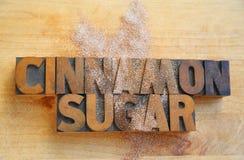 Cinnamon sugar words on cutting board Royalty Free Stock Photo