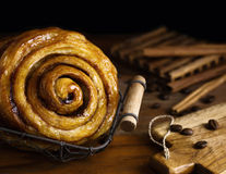 Cinnamon swirl with coffee beans rustic low key background Stock Photos