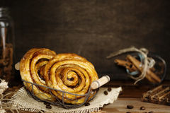 Cinnamon swirl with coffee beans rustic low key background Stock Images