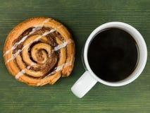 Cinnamon Swirl Danish Pastry With a Mug of Black Coffee Stock Photography