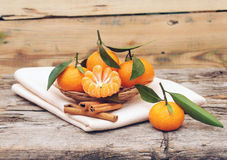 Cinnamon and tangerines Royalty Free Stock Photo