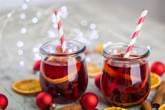 Cinnamon tea with orange peels and sticks red mulled wine hot pu Stock Photo
