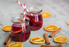 Cinnamon tea with orange peels and sticks red mulled wine hot pu Stock Images