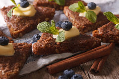 Cinnamon toast with blueberries and mint macro. horizontal Royalty Free Stock Photos