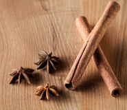 Cinnamon,  truestar on wooden  background Royalty Free Stock Images