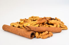 Cinnamon and walnuts Stock Images