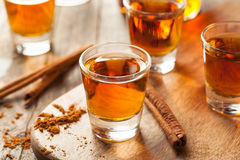 Cinnamon Whiskey Bourbon in a Shot Glass. Ready to Drink Stock Photo