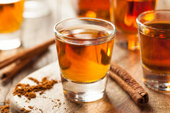 Cinnamon Whiskey Bourbon in a Shot Glass. Ready to Drink Stock Photos