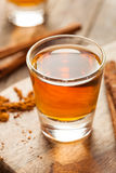 Cinnamon Whiskey Bourbon in a Shot Glass. Ready to Drink Stock Image