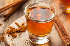 Cinnamon Whiskey Bourbon in a Shot Glass. Ready to Drink Royalty Free Stock Image