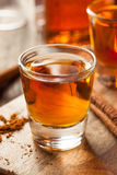 Cinnamon Whiskey Bourbon in a Shot Glass. Ready to Drink Royalty Free Stock Photography