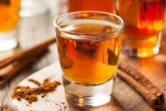 Cinnamon Whiskey Bourbon in a Shot Glass. Ready to Drink Stock Images