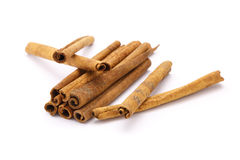 Cinnamon. On the white background Royalty Free Stock Images