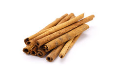 Cinnamon. On the white background Stock Images