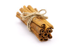 Cinnamon. On the white background Royalty Free Stock Photography