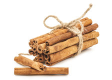 Cinnamon on white background Royalty Free Stock Images