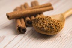 Cinnamon, whole sticks with a heap of powder Stock Photo