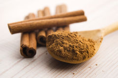 Cinnamon, whole sticks with a heap of powder Stock Photography