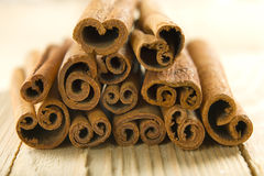 Cinnamon on the wooden surface Stock Image