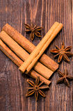 Cinnamone and anisetree on wooden table. Cinnamone and anisetree on dark wooden table Stock Photography